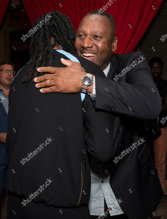Snoop Dogg and Joe Carter seen on the red carpet at the Joe Carter Classic after party at the Shangri-La Hotel, in Toronto, Canada