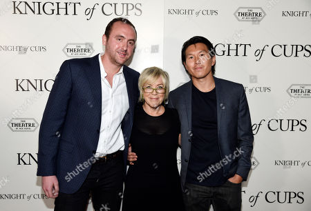 """Nicolas Gonda, left, Sarah Green, center, and Kenneth Kao, producers of """"Knight of Cups,"""" pose together at the premiere of the film at The Theatre at Ace Hotel, in Los Angeles"""