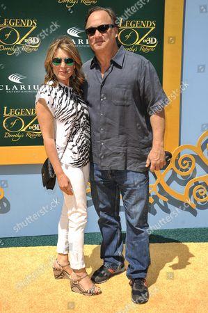 "Jim Belushi, right, and Jennifer Sloan arrive at the LA Premiere of ""Legends of Oz: Dorothy's Return"" on in Los Angeles"