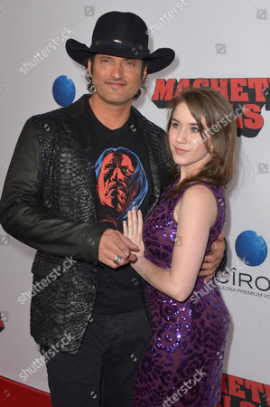 """Stock Picture of Robert Rodriguez and Marci Madison arrive at the premiere of """"Machete Kills"""" at Regal Cinemas L.A. Live on in Los Angeles"""