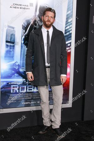 """Stock Photo of Writer Joshua Zetumer attends the premiere of """"RoboCop"""" at the TCL Chinese Theatre, on Monday, February, 10, 2014 in Los Angeles"""