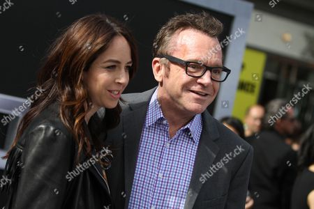 "Ashley Groussman, left, and Tom Arnold arrive at the LA Premiere of ""Terminator Genisys"" at the Dolby Theatre, in Los Angeles"