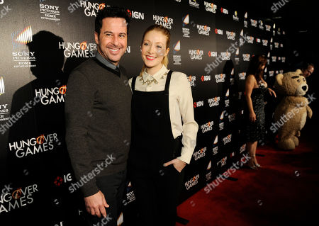 """Jonathan Silverman, a cast member in """"The Hungover Games,"""" poses with his wife, actress Jennifer Finnigan, at the premiere of the film, in Los Angeles"""