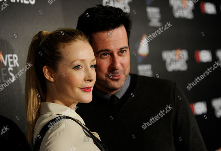 """Actress Jennifer Finnigan poses with her husband Jonathan Silverman, a cast member in """"The Hungover Games,"""" at the premiere of the film, in Los Angeles"""