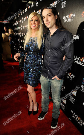 """Tara Reid, left, a cast member in """"The Hungover Games,"""" poses with her boyfriend Erez Eisen at the premiere of the film """"The Hungover Games"""", in Los Angeles"""