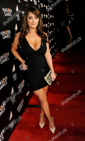 """Stock Image of Actress Kirsty Hill poses at the premiere of the film """"The Hungover Games"""", in Los Angeles"""