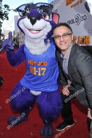 """Surly the Squirrel and director Peter Lepeniotis are seen at the premiere of the animated film """"The Nut Job"""" on in Los Angeles, California"""