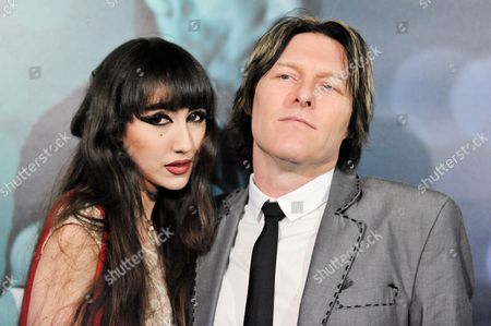 "Ciscandra Nostalghia, left, and Tyler Bates arrive at the LA Special Screening Of ""John Wick"", in Los Angeles"