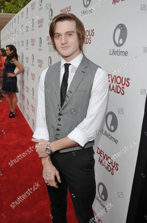 Eddie Hassell arrives at Lifetime's Devious Maids Premiere Party, on in Pacific Palisades, Calif