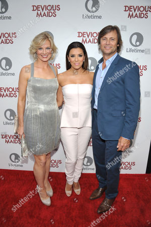 From left, Melinda Page Hamilton, Eva Longoria and Grant Show arrive at Lifetime's Devious Maids Premiere Party, on in Pacific Palisades, Calif