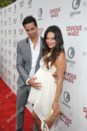 Matt Cedeno, left, and Erica Franco arrive at Lifetime's Devious Maids Premiere Party, on in Pacific Palisades, Calif