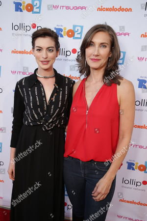 """Anne Hathaway and Lollipop Theater Networks' Evelyn Iocolano seen at Lollipop Theater Network's """"A Night Under the Stars"""" at Nickelodeon Animation Studios, in Burbank, CA"""