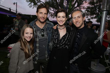 """Lola Ray Facinelli, Peter Facinelli, Anne Hathaway and Adam Shulman seen at Lollipop Theater Network's """"A Night Under the Stars"""" at Nickelodeon Animation Studios, in Burbank, CA"""