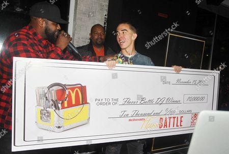 Stock Photo of DJ Rhetorik Host DJ Clark Kent present the check to the winner Dj Rhetorik at the McDonald's Flavor Battle at Orbit, in New York
