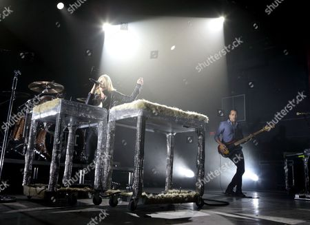 Stock Photo of Emily Haines, left, and Joshua Winstead of the band Metric perform in concert during their I Can See The End Tour 2016 at the Fillmore, in Philadelphia