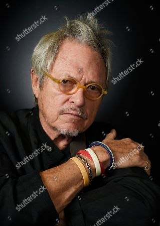 """Filmmaker Michael Lindsay-Hogg poses for a portrait in Los Angeles. Some of Lindsay-Hogg's early videos of the Beatles are featured in the new CD/DVD and CD/Blu-ray package for """"Beatles 1,"""" released in early Nov. 2015"""