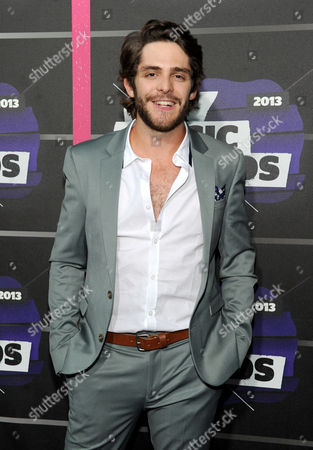 Thomas Rhett arrives at the 2013 CMT Music Awards in Nashville, Tenn. Thomas Rhett, whose full name is Thomas Rhett Akins Jr., grew up in the limelight of his father success, even appearing on television and on stage singing songs with his dad, Rhett Akins. The father and son songwriters managed to get credits on five of the top 10 songs on country radio in early October 2013