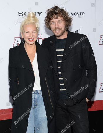 """Singer Sia Furler and fiance Erik Anders Lang attend the world premiere of """"Annie"""" at the Ziegfeld Theatre, in New York"""
