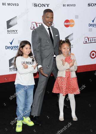 """Actor Jamie Foxx and his daughter, right, Annalise Bishop attend the world premiere of """"Annie"""" at the Ziegfeld Theatre, in New York"""