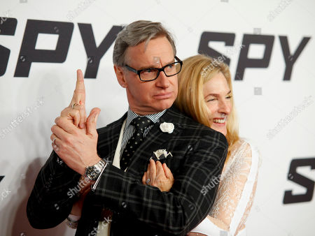 """Paul Feig, left, and Laurie Karon, right, attend the premiere of """"Spy"""" at AMC Loews Lincoln Square, in New York"""