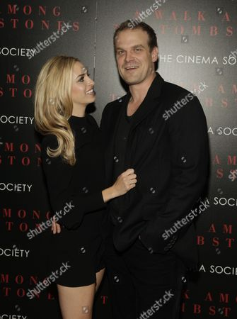 """Margaret Judson, left, and David Harbour, right, attend a screening of """"A Walk Among The Tombstones"""" on in New York"""