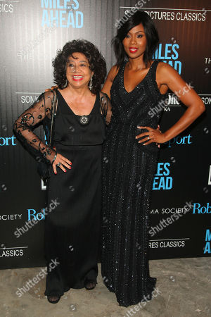 """Frances Davis, left, and Emayatzy Corinealdi, right, attend the special screening of """"Miles Ahead"""" at Metrograph, in New York"""