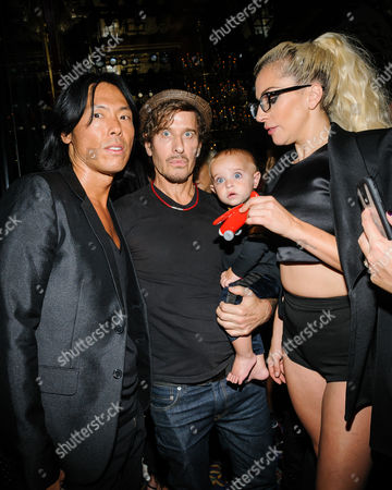 Stephen Gan, from left, guest, and Lady Gaga appear at the Maxwell Spring/Summer 2017 collection at The Russian Tea Room, in New York