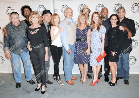 """Stock Picture of From left, Troy Evans, Concetta Tomei, Nancy Giles, Robert Picardo, Marg Helgenberger, John Sacret Young, Chloe Webb, Brian Wimmer, Dana Delany, Michael Boatman, Ricki Lake, and Jeff Kober arrive at the PaleyFest Previews Fall TV's Fall Flashback Reflection's: """"China Beach"""" 25 Years Later at The Paley Center for Media on in Beverly Hills, Calif"""