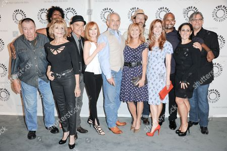 """From left, Troy Evans, Concetta Tomei, Nancy Giles, Robert Picardo, Marg Helgenberger, John Sacret Young, Chloe Webb, Brian Wimmer, Dana Delany, Michael Boatman, Ricki Lake, and Jeff Kober arrive at the PaleyFest Previews Fall TV's Fall Flashback Reflection's: """"China Beach"""" 25 Years Later at The Paley Center for Media on in Beverly Hills, Calif"""