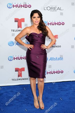 Yarel Ramos arrives for the Premios Tu Mundo Awards at the American Airlines Arena on in Miami, Florida