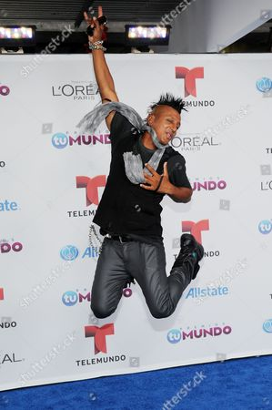 Stock Photo of DJ Ravi Drums arrives for the Premios Tu Mundo Awards at the American Airlines Arena on in Miami, Florida