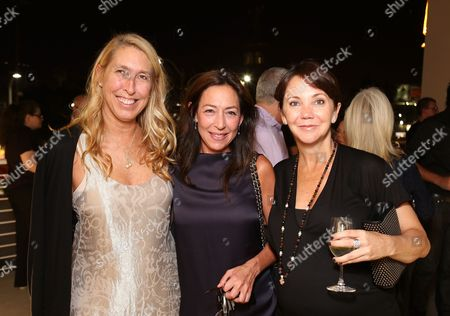 From left, Lisa Phillips, Shaun Regen and Lisa Schiff pose during the reception for the inaugural exhibition at Regen Projects' new Hollywood gallery, in Los Angeles, Calif