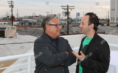 Stock Picture of From left, Lari Pittman and Gabriel Kuri talk during the reception for the inaugural exhibition at Regen Projects' new Hollywood gallery, in Los Angeles, Calif