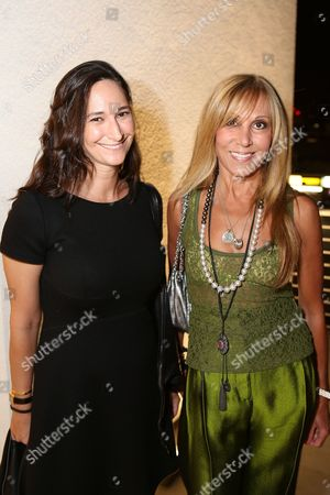 From left, Bettina Korek and Rosette Delug pose during the reception for the inaugural exhibition at Regen Projects' new Hollywood gallery, in Los Angeles, Calif