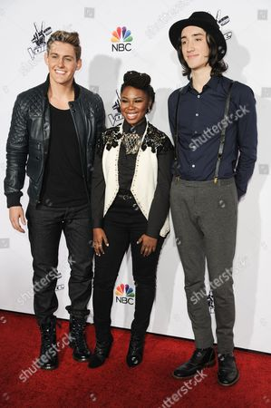 "Stock Image of From left, Ryan Sill, Anita Antoinette and Taylor John Williams arrive at Season 7 Of ""The Voice"" Red Carpet Event, in Universal City, Calif"