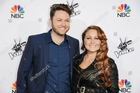 """Luke Wade, left, and DaNica Shirey arrive at Season 7 Of """"The Voice"""" Red Carpet Event, in Universal City, Calif"""