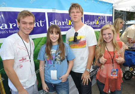 From left, Starlight StarPower Ambassadors, Devon Gearhart, Kay Panabaker, Austin Anderson, and Sierra McCormick attend the 2012 FAME Back-To-School event, in Los Angeles. The Starlight Children's Foundation invited families to participate in the event, where participants were given free school supplies and shoes