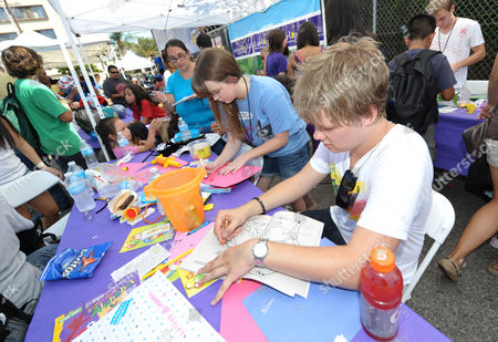 COMMERCIAL IMAGE - Starlight StarPower Ambassadors Kay Panabaker, left, and Austin Anderson attend the 2012 FAME Back-To-School event, in Los Angeles. The Starlight Children's Foundation invited families to participate in the event, where participants were given free school supplies and shoes