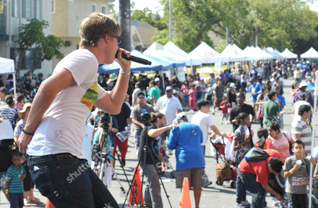 Starlight StarPower Ambassador Austin Anderson performs at the 2012 FAME Back-To-School event, in Los Angeles. The Starlight Children's Foundation invited families to participate in the event, where participants were given free school supplies and shoes