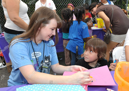 Stock Picture of Starlight StarPower Ambassador Kay Panabaker, left, attends the 2012 FAME Back-To-School event, in Los Angeles. The Starlight Children's Foundation invited families to participate in the event, where participants were given free school supplies and shoes