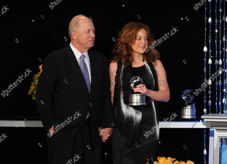 """Susie Fogelson (right) of The Food Network accepts the Academy Honor award for """"Hunger Hits Home"""" from presenter, CEO of Share Our Strength Billy Shore onstage at the Academy of Television Arts & Sciences Presents """"The 6th Annual Television Honors"""" at the Beverly Hills Hotel on in Beverly Hills, California"""