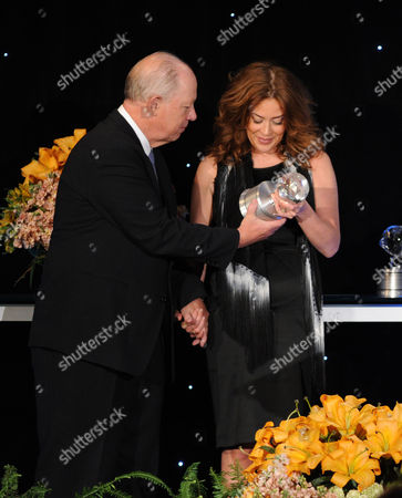 """Stock Picture of Susie Fogelson (right) of The Food Network accepts the Academy Honor award for """"Hunger Hits Home"""" from presenter, CEO of Share Our Strength Billy Shore onstage at the Academy of Television Arts & Sciences Presents """"The 6th Annual Television Honors"""" at the Beverly Hills Hotel on in Beverly Hills, California"""