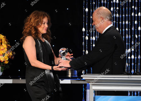 """Susie Fogelson (left) of The Food Network accepts the Academy Honor award for """"Hunger Hits Home"""" from presenter, CEO of Share Our Strength Billy Shore onstage at the Academy of Television Arts & Sciences Presents """"The 6th Annual Television Honors"""" at the Beverly Hills Hotel on in Beverly Hills, California"""