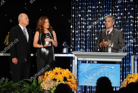 """Susie Fogelson (center) of The Food Network and Dan Cutforth (right) of Magical Elves accept the Academy Honor award for """"Hunger Hits Home"""" from presenter, CEO of Share Our Strength Billy Shore onstage at the Academy of Television Arts & Sciences Presents """"The 6th Annual Television Honors"""" at the Beverly Hills Hotel on in Beverly Hills, California"""