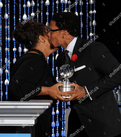 "Executive Producer DL Hughley (R) accepts the Academy Honor award for ""DL Hughley: The Endangered List"" from presenter, actress Yvette Nicole Brown onstage at the Academy of Television Arts & Sciences Presents ""The 6th Annual Television Honors"" at the Beverly Hills Hotel on in Beverly Hills, California"