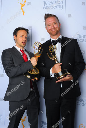 "Kyle Dunnigan, left, and Jim Roach, winners of the award for outstanding original music and lyrics for ""Inside Amy Schumer"", pose for a portrait at the Television Academy's Creative Arts Emmy Awards at Microsoft Theater, in Los Angeles"