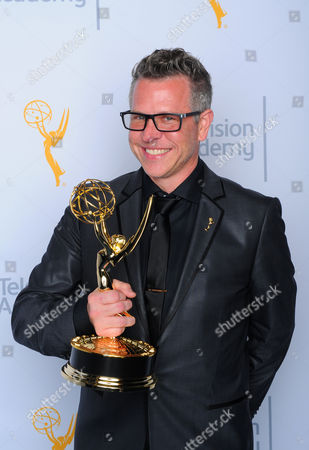 """Monte C. Haught, winner of the award for outstanding hairstyling for a limited series or movie for """"American Horror Story: Freak Show"""", poses for a portrait at the Television Academy's Creative Arts Emmy Awards at Microsoft Theater, in Los Angeles"""