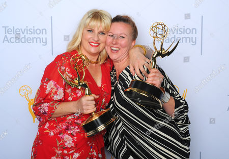"""Marie Schley, left, and Nancy Jarzynko, winners of the award for outstanding costumes for a contemporary series, limited series or movie for """"Transparent"""", pose for a portrait at the Television Academy's Creative Arts Emmy Awards at Microsoft Theater, in Los Angeles"""