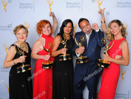 "Stock Photo of Inga Thrasher, from left, Jennifer Serio, Jodi Mancuso, Joe Whitmeyer and Cara Hannah, winners of the award for outstanding hairstyling for a multi camera series or special for ""Saturday Night Live"", pose for a portrait at the Television Academy's Creative Arts Emmy Awards at Microsoft Theater, in Los Angeles"