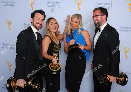 "Stock Image of Rhys Thomas, from left, Erin Doyle, Lindsay Shookus, and Erik Keyword, winners of the award for outstanding variety special for ""The Saturday Night Live 40th Anniversary Special"", pose for a portrait at the Television Academy's Creative Arts Emmy Awards at Microsoft Theater, in Los Angeles"